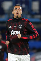 Chris Smalling of Manchester United warms up ahead of kick-off  during Chelsea vs Manchester United, Emirates FA Cup Football at Stamford Bridge on 18th February 2019