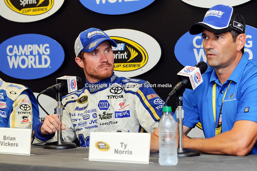 July 14, 2013 - Loudon, New Hampshire U.S. - Sprint Cup Series driver Brian Vickers (55) listens as  Executive Vice President of Business Development and General Manager of Michael Waltrip Racing, Ty Norris, answers a question about his victory and future with the team at the NASCAR Sprint Cup Series Camping World RV Sales 301 held at the New Hampshire Motor Speedway in Loudon, New Hampshire.   Eric Canha/CSM