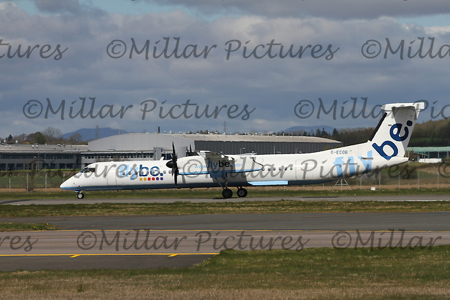 A Flybe Bombardier Dash 8 Q400 Registration G-ECOB at Glasgow Airport on 23.4.16 going to Belfast City George Best Airport.
