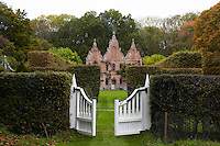 The three gables of the house seen from beyond the rear garden gate