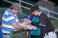 Kannapolis Intimidators pitcher Jimmy Lambert (12) autographs baseball cards for a fan prior to the game against the Asheville Tourists at Kannapolis Intimidators Stadium on May 6, 2017 in Kannapolis, North Carolina.  The Intimidators walked-off the Tourists 7-6.  (Brian Westerholt/Four Seam Images)