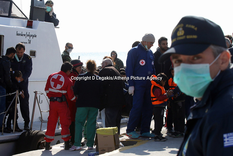 Pictured: A Coastguard officer looks on as the vessel carrying some of the illegal immigrants docks to Ierapetra Thursday 27 November 2014<br /> Re: One of the largest refugee boats in recent months has disembarked refugees in Ierapetra, Crete. The freighter Baris, carrying 700 people thought to be from Syria and Afghanistan, is being towed by a Greek frigate.<br /> Officials and Red Cross volunteers prepared an indoor basketball stadium as interim shelter in the southern Cretan port town of Ierapetra on Wednesday ahead of the migrants' expected arrival.<br /> Greek officials said the Baris, which lost propulsion on Tuesday, was being towed slowly in poor sea conditions and would arrive after nightfall, probably early Thursday.<br /> They said it was unclear which Mediterranean location had been the departure point for the 77-meter (254-foot) vessel, which was sailing under the flag of the Pacific nation of Kiribati.