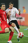10 August 2008: Feng Xiaoting (CHN) (3) defends Kevin Mirallas (BEL) (9).  The men's Olympic soccer team of Belgium defeated the men's Olympic soccer team of China 2-0 at Shenyang Olympic Sports Center Wulihe Stadium in Shenyang, China in a Group C round-robin match in the Men's Olympic Football competition.