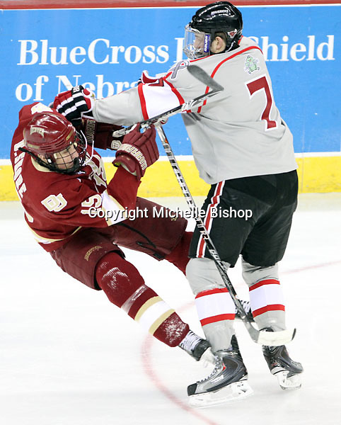 UNO's Michael Young sends Denver's Drew Shore to the ice during the first period. Denver beat Nebraska-Omaha 4-2 Saturday night at Qwest Center Omaha. (Photo by Michelle Bishop)