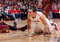 Ohio State Buckeyes guard Aaron Craft (4) looks to the referee as he is called for a foul while shooting a layup during the first half of the NCAA men's basketball game between the Ohio State Buckeyes and the Minnesota Golden Gophers at Value City Arena in Columbus, Ohio, on Saturday, Feb. 22, 2014. At the end of the first half, Minnesota led Ohio State, 28-18. (Columbus Dispatch/Sam Greene)