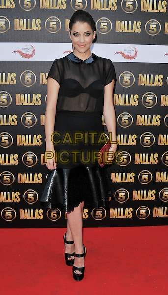 Julie Gonzalo.The Channel 5 Launch Party for the new series of 'Dallas', Old Billingsgate Market, London, England..21st August 2012.full length black sheer blouse skirt see through thru bra leather red clutch bag sandals .CAP/WIZ.© Wizard/Capital Pictures.