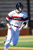 Justin Glass (16) of the Cincinnati Bearcats hustles down the first base line against the Radford Highlanders at Wake Forest Baseball Park on February 22, 2014 in Winston-Salem, North Carolina.  The Highlanders defeated the Bearcats 6-5.  (Brian Westerholt/Four Seam Images)