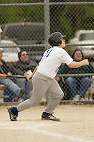 Nic Taylor bats during a Little League game at Memorial Park in Belton, Missouri on May 6, 2006.