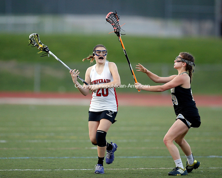 Southbury, CT- 07 May 2015-050715CM07-  Pomperaug's  Kayla Kasmire carries the ball as Joel Barlow's Emma Coppock defends during their SWC lacrosse matchup in Southbury on Thursday.   Christopher Massa Republican-American