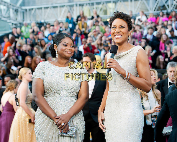 Octavia Spencer, Oscar®-nominee for Performance by an Actress in a Supporting Role, is interviewed by Robin Roberts .Arrivals at the 84th Annual Academy Awards® in Hollywood, CA., USA..February 26, 2012.*Editorial Use Only*.oscars half length  dress silver white.CAP/A.M.P.A.S./NFS.©A.M.P.A.S. Supplied by Capital Pictures.