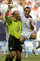July 24, 2005: East Rutherford, NJ, USA:  USMNT captain and goalkeeper Kasey Keller (18) celebrates with teammate Landon Donovan (10) after winning the CONCACAF Gold Cup at Giants Stadium.  The USMNT won 3-1 on penalty kicks.