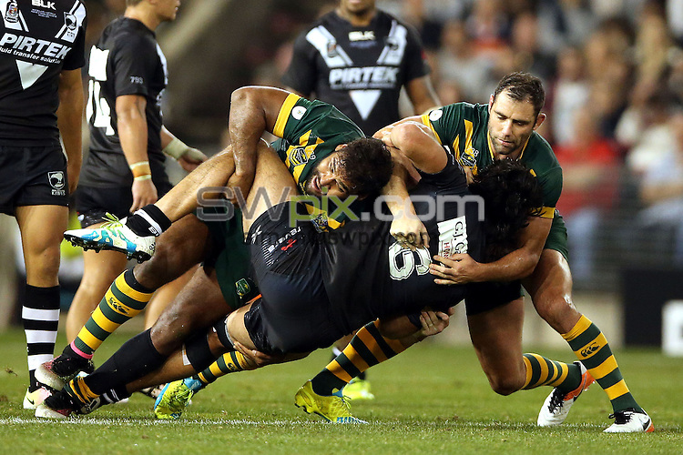 Tohu Harris tackled by Sam Thaiday and Cameron Smith<br /> Trans Tasman NZRL Kiwis v Australia Test Match at Hunter Stadium, Newcastle, Australia. Friday 6 May 2016. Photo: Paul Seiser / www.photosport.nz / SWpix.com