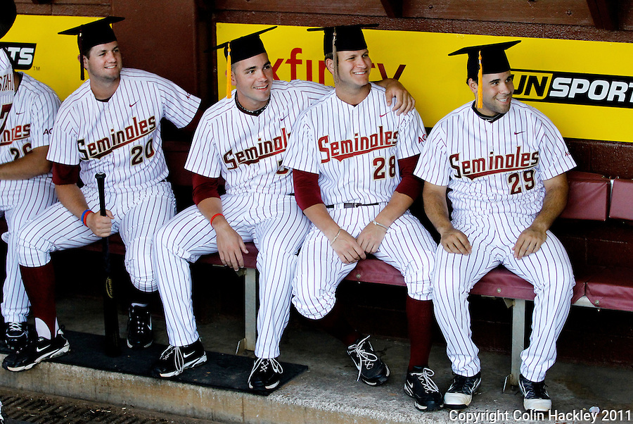 TALLAHASSEE, FL 5/7/11-FSU-UCFBASE11 CH-Florida State graduates Daniel Bennett, left, Robby Scott, Tyler Everett and Rafael Lopez pose for a photo in the dugout prior to the University of Central Florida game Saturday at Dick Howser Stadium in Tallahassee. The eight graduates on the team were recognized in a pre-grame ceremony with FSU President Eric Barron. The Seminoles lost to the Knights 10-14..COLIN HACKLEY PHOTO