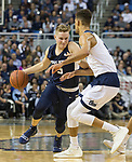 Utah State guard Sam Merrill (5) drives past Nevada  forward Trey Porter in the second half of an NCAA college basketball game in Reno, Nev.,  Wednesday, Jan. 2, 2019. (AP Photo/Tom R. Smedes)