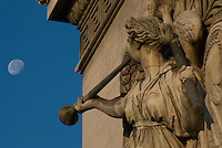 Arc de Triomphe, Paris.  Detail of Trumpeter in Cortot's The Triumph of Napoleon sculpture on the Champs Elysee side of the Arc.  Early morning shot with 3/4 moon near end of trumpet.  July 2008