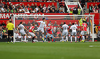 Pictured: Ki Sung Yueng of Swansea (4th L) heads the ball away. Saturday 16 August 2014<br />