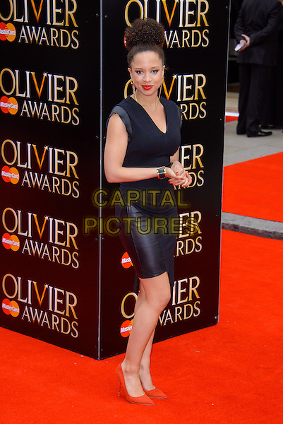 Natalie Gumede.The Laurence Olivier Awards held at the Royal Opera House - Arrivals, London, England..April 28th, 013.full length black dress leather pink shoes .CAP/CJ.©Chris Joseph/Capital Pictures.