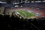 01/11/11--Oregon fans cheer for the Ducks as they enter the University of Phoenix Stadium before the start of the BCS National Championship..Photo by Jaime Valdez...