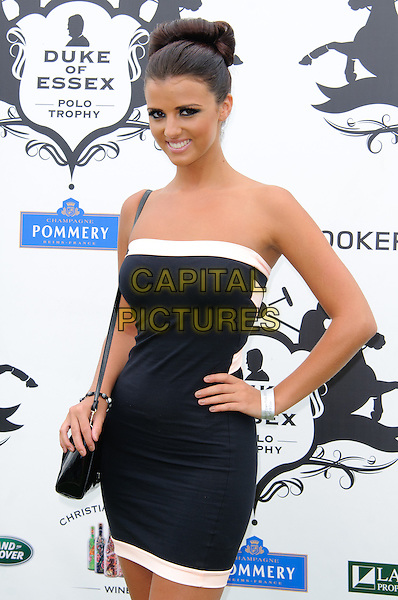 Lucy Meck.The Duke of Essex Polo Trophy at Gaynes Park, Epping, England, UK, .July 9th 2011..half length strapless white black dress hand on hip trim bag smiling hair up towie.CAP/CJ.©Chris Joseph/Capital Pictures.