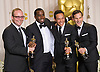"SEAN COMBS ""P Diddy"" .and the winners of the Best Documentary Feature with ""Undefeated, Combs was the executive producer..texts on his mobile at the 84th Academy Awards, Kodak Theatre, Hollywood, Los Angeles_26/02/2012.Mandatory Photo Credit: ©Dias/Newspix International..**ALL FEES PAYABLE TO: ""NEWSPIX INTERNATIONAL""**..PHOTO CREDIT MANDATORY!!: NEWSPIX INTERNATIONAL(Failure to credit will incur a surcharge of 100% of reproduction fees)..IMMEDIATE CONFIRMATION OF USAGE REQUIRED:.Newspix International, 31 Chinnery Hill, Bishop's Stortford, ENGLAND CM23 3PS.Tel:+441279 324672  ; Fax: +441279656877.Mobile:  0777568 1153.e-mail: info@newspixinternational.co.uk"