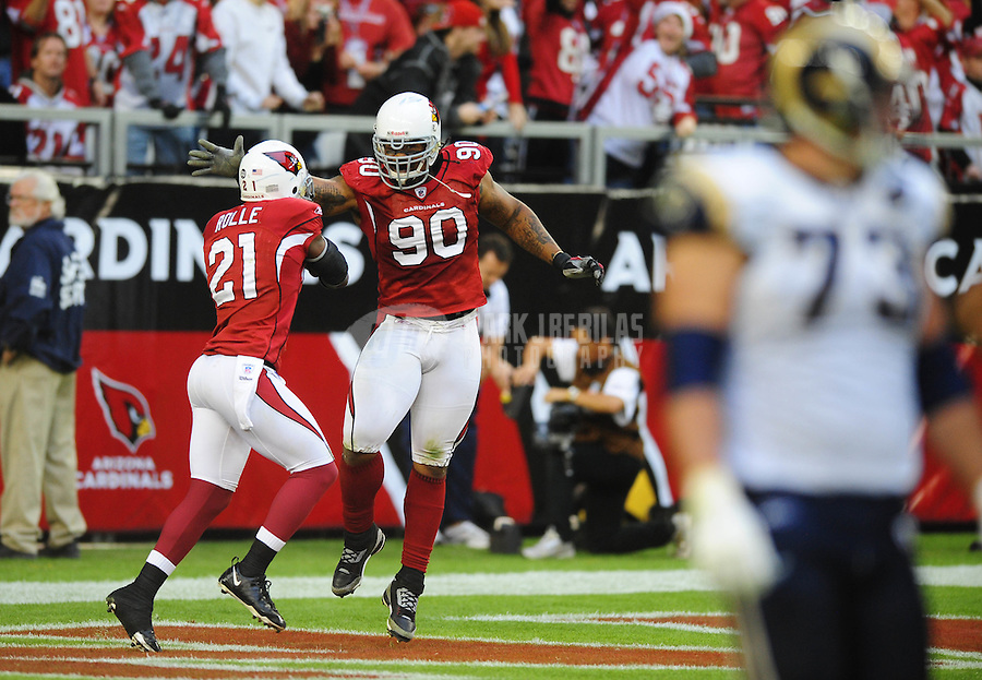 Dec. 7, 2008; Glendale, AZ, USA; Arizona Cardinals defensive tackle (90) Darnell Dockett is congratulated by safety (21) Antrel Rolle after recovering a fumble for a touchdown in the third quarter against the St. Louis Rams at University of Phoenix Stadium. The Cardinals defeated the Rams 34-10 to clinch the NFC West division title. Mandatory Credit: Mark J. Rebilas-