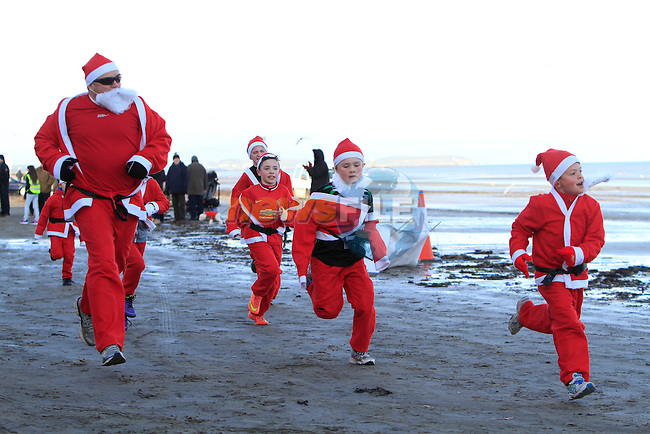 Racing to the finish line during The Great Santa 3k and Santa's little helpers run in Bettystown on Sunday 7th December 2014.<br /> Picture:  Thos Caffrey / www.newsfile.ie