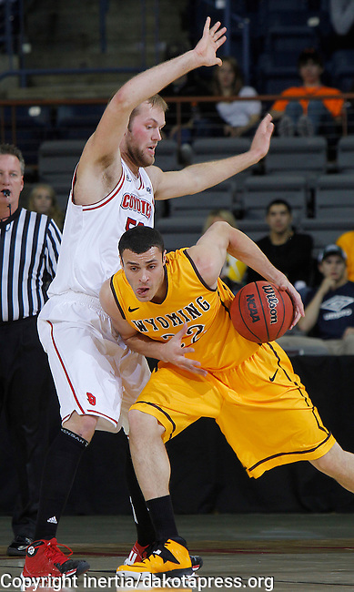 RAPID CITY, S.D. -- DECEMBER 7, 2013 -- Larry Nance Jr. #22 of Wyoming leans into Trevor Gruis #50 of South Dakota during their game Saturday at the Rushmore Plaza Civic Center Ice arena in Rapid City, S.D.  (Photo by Dick Carlson/Inertia)