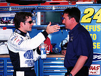 NASCAR driver Jeff Gordon (left) talks with his new crew chief Robby Loomis during as practice session at Daytona International Speedway 2/16/00.(Photo by Brian Cleary)