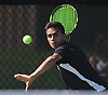 Abhinav Srivastava of Half Hollow Hills East returns a volley from Jackson Weisbrot of Hills West (not in picture) in the first singles match of the Suffolk County varsity boys tennis team championship at Half Hollow Hills High School East on Wednesday, May 17, 2017.