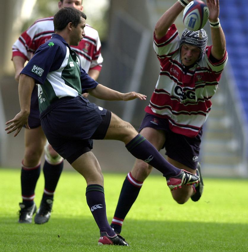 Photo  Peter Spurrier.21/09/2003..Zurich Premiership Rugby. London Irish v Gloucester..Alex Brown charge's down Barry Everitt's kick.