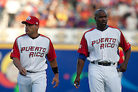 9 March 2009: #7 Ivan Rodriguez and #21 Carlors Delgado are seen prior to the 2009 World Baseball Classic Pool D game 4 at Hiram Bithorn Stadium in San Juan, Puerto Rico. Puerto Rico wins 3-1 over Netherlands