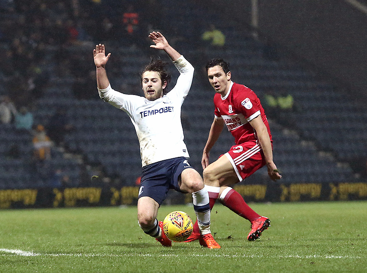 Preston North End's Ben Pearson goes down under the challenge from Middlesbrough's Stewart Downing<br /> <br /> Photographer Rich Linley/CameraSport<br /> <br /> The EFL Sky Bet Championship - Preston North End v Middlesbrough - Monday 1st January 2018 - Deepdale Stadium - Preston<br /> <br /> World Copyright &copy; 2018 CameraSport. All rights reserved. 43 Linden Ave. Countesthorpe. Leicester. England. LE8 5PG - Tel: +44 (0) 116 277 4147 - admin@camerasport.com - www.camerasport.com