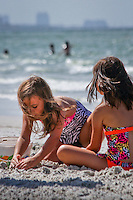 Two young girls build a sandcastle along the Gulf of Mexico at Fort Myers Beach, Florida, USA. Photo by Debi Pittman Wilkey