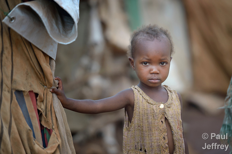A girl in a camp for more than 12,000 internally displaced persons located on the grounds of the Roman Catholic Cathedral of St. Mary in Wau, South Sudan. Most of the families here were displaced in June, 2016, when armed conflict engulfed Wau.<br /> <br /> Norwegian Church Aid, a member of the ACT Alliance, has provided relief supplies to the displaced in Wau, and has supported the South Sudan Council of Churches as it has struggled to mediate the conflict in Wau.