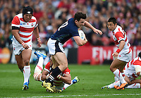 Matt Scott of Scotland takes on the Japan defence. Rugby World Cup Pool B match between Scotland and Japan on September 23, 2015 at Kingsholm Stadium in Gloucester, England. Photo by: Patrick Khachfe / Onside Images