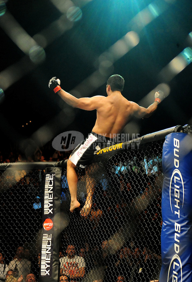 Jan. 31, 2009; Las Vegas, NV, USA; UFC fighter Lyoto Machida celebrates after knocking out Thiago Silva (not pictured) during the light heavyweight bout in UFC 94 at the MGM Grand Hotel and Casino. Mandatory Credit: Mark J. Rebilas-