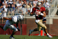 TALLAHASSEE, FL 9/18/10-FSU-BYU FB10 CH-Florida State's Christian Ponder scrambles away from Brigham Young's Vic So'oto during second half action Saturday at Doak Campbell Stadium in Tallahassee. The Seminoles beat the Cougars 34-10.<br /> COLIN HACKLEY PHOTO