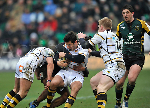 4.2.2012. Northampton, England. LV=Cup Northampton Saints vs London Wasps.Hugo Southwell of London Wasps tackled during Northampton Saints in the forth round of the LV= Cup against Northampton Saints at Franklin's Gardens, Northampton, England..