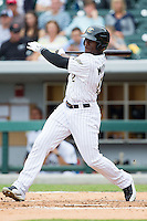 Jared Mitchell (21) of the Charlotte Knights follows through on his swing against the Pawtucket Red Sox at BB&T Ballpark on August 10, 2014 in Charlotte, North Carolina.  The Red Sox defeated the Knights  6-4.  (Brian Westerholt/Four Seam Images)