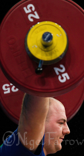 11 DEC 2011 - LONDON, GBR - Peter Nagy (HUN) lifts during the men's +105kg category Snatch at the London International Weightlifting Invitational and 2012 Olympic Games test event held at the ExCel Exhibition Centre in London, Great Britain .(PHOTO (C) NIGEL FARROW)