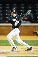 Kevin Conway (8) of the Wake Forest Demon Deacons follows through on his swing against the West Virginia Mountaineers at Wake Forest Baseball Park on February 24, 2013 in Winston-Salem, North Carolina.  The Demon Deacons defeated the Mountaineers 11-3.  (Brian Westerholt/Four Seam Images)