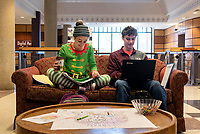 Studying for December finals in the library, with Alexis Higgins dressed seasonally as a Christmas elf and Zach Spangler.<br />  (photo by Colleen McInnis / &copy; Mississippi State University)