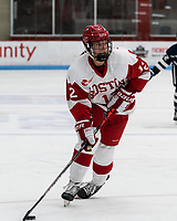 BOSTON, MA - FEBRUARY 16: Kaleigh Donnelly #12 of Boston University looks to pass during a game between University of New Hampshire and Boston University at Walter Brown Arena on February 16, 2020 in Boston, Massachusetts.