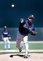 Dennis Martinez of the Seattle Mariners during a spring training game at Peoria Sports Complex in Peoria, Arizona during the 1997 season.(Larry Goren/Four Seam Images)