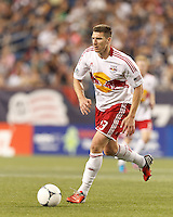 New York Red Bulls forward Kenny Cooper (33) dribbles. In a Major League Soccer (MLS) match, New England Revolution defeated New York Red Bulls, 2-0, at Gillette Stadium on July 8, 2012.