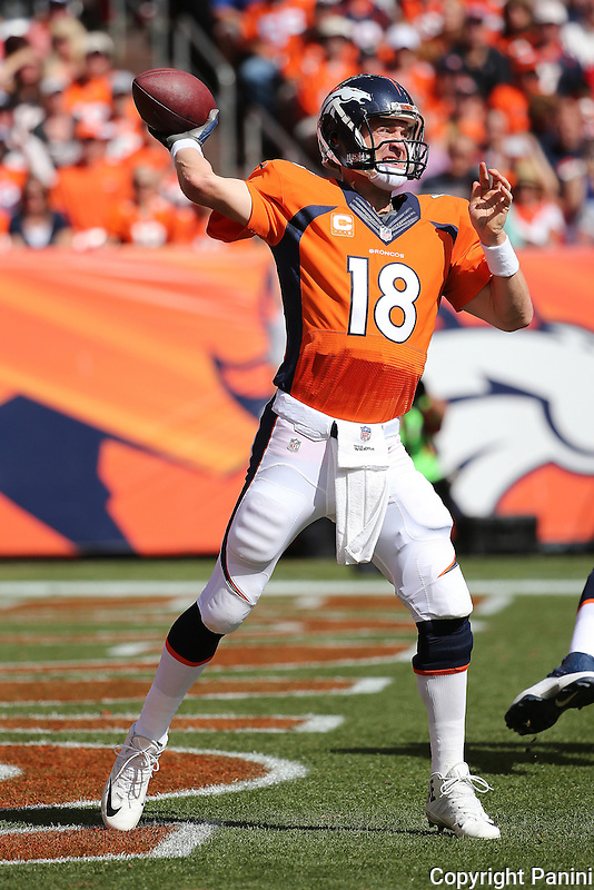 Denver Broncos quarterback Peyton Manning #12 passes against the Kansas City Chiefs during an NFL game at Sports Authority Field at Mile High Stadium in Denver on Sunday, Sept. 14, 2014. (AP Photo/Michael Zito)