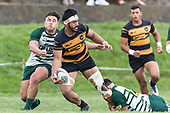 Tulele Masoe offloads the ball as he is tackled by Petelo Ikenasio. Counties Manukau Premier Counties Power Club Rugby Round 4 game between Bombay and Manurewa, played at Bombay on Saturday March 31st 2018. <br /> Manurewa won the game 25 - 17 after trailing 15 - 17 at halftime.<br /> Bombay 17 - Ki Anufe, Chay Macwood tries, Tim Cossens, Ki Anufe conversions,  Ki Anufe penalty. <br /> Manurewa Kidd Contracting 25 - Peter White 2 , Willie Tuala 2 tries, James Faiva conversion,  James Faiva penalty.<br /> Photo by Richard Spranger.