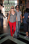 June 1st 2012 ..Sharon Stone & Boyfriend Martin Mica visit Doctor in Beverly Hills .Wearing red jeans brown tan ostrich purse handbag  ...AbilityFilms@YAHOO.COM.805 427 3519.www.AbilityFilms.com..