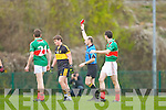 referee Michael Collins issues a straight red card to Crokes Chris Brady during the Munster Club championships in Killarney on Saturday