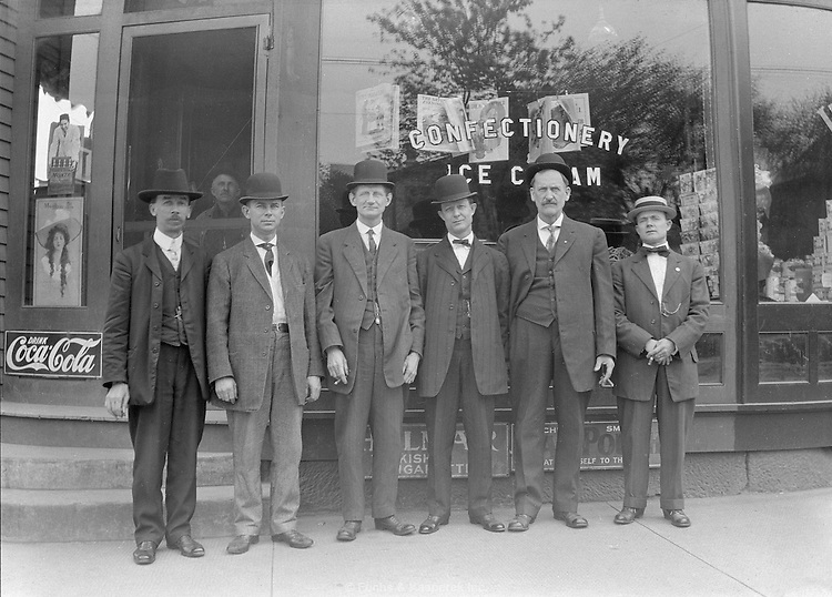 A group of men pose outside Pfahl's Confectionary in Akron, Ohio. May 15, 1911.